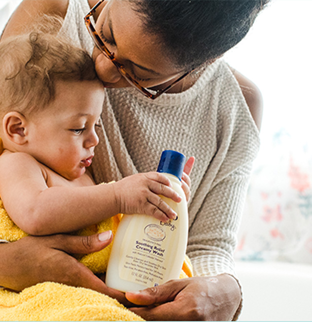 baby and mum with aveeno baby lotion